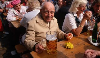 A table of happy Germans enjoys the Oktoberfest experience.   (Photo by Peter Turnley/Corbis/VCG via Getty Images)