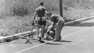 Danish cyclist Knud Enemark Jensen (1936 ? 1960) is attended by a Danish official after collapsing with heat stroke and suffering a fractured skull during the 100 kilometre team time trial at the Rome Olympics, 26th August 1960. He died a few hours later in hospital. Two of his team mates (left) resumed the race, unaware of the seriousness of his condition. Jensen's body tested positive for the drugs amphetamine and Roniacol at a subsequent autopsy. (Photo by Central Press/Hulton Archive/Getty Images)