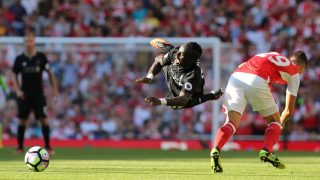 Arsenal's Swiss midfielder Granit Xhaka (R) challenges Liverpool's Senegalese midfielder Sadio Mane (L) during the English Premier League football match between Arsenal and Liverpool at the Emirates Stadium in London on August 14, 2016.  / AFP PHOTO / Lee MILLS / RESTRICTED TO EDITORIAL USE. No use with unauthorized audio, video, data, fixture lists, club/league logos or 'live' services. Online in-match use limited to 75 images, no video emulation. No use in betting, games or single club/league/player publications.  /