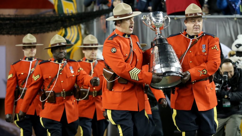 WINNIPEG, CANADA - NOVEMBER 29:  Members of the RMCP bring the Grey Cup onto the field prior to Grey Cup 103 between the Edmonton Eskimos  and Ottawa Redblacks at Investors Group Field on November 29, 2015 in Winnipeg, Manitoba, Canada. (Photo by Trevor Hagan/Getty Images)