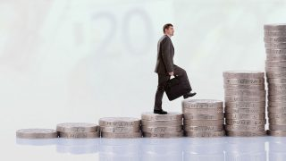 Businessman climbing money stairs, promotion concept