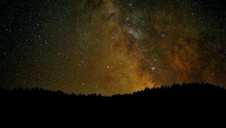 Amazing night sky stars with milky way on mountain background
