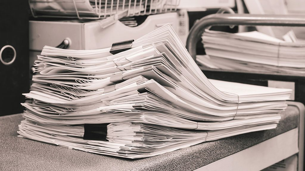 Grey Pile of Papers Background