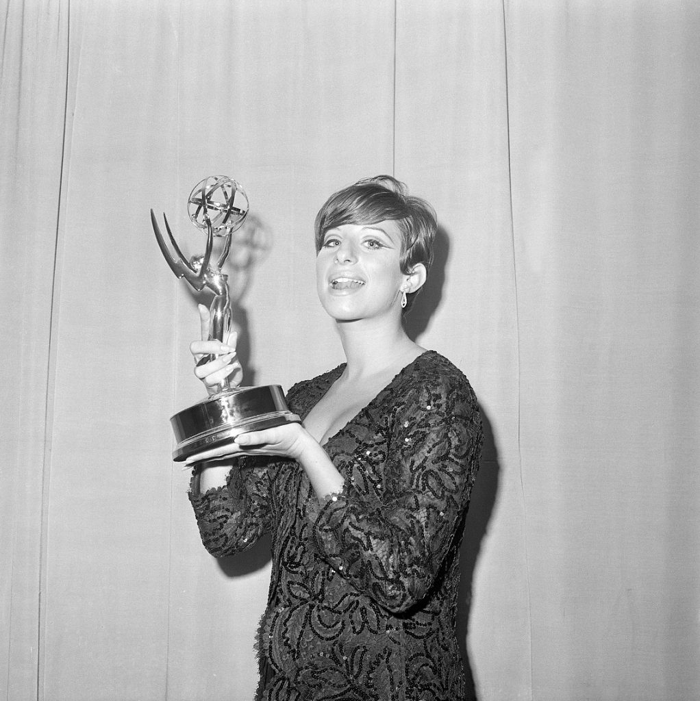 (Original Caption) 9/12/1965-A radiant Barbara Streisand is shown holding the Emmy award she won for outstanding achievement presented to her here late September 12 at television's Emmy Awards. Other top winners were Dick van Dyke, Lynn Fontaine and Leonard Bernstein. Filed 9/13/1965.
