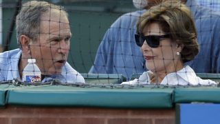 ARLINGTON, TX - AUGUST 10: Former U.S. President George W. Bush and Laura Bush attend a game between the Colorado Rockies and the Texas Rangers at Globe Life Park in Arlington on August 10, 2016 in Arlington, Texas.   Ronald Martinez/Getty Images/AFP / AFP PHOTO / GETTY IMAGES NORTH AMERICA / RONALD MARTINEZ