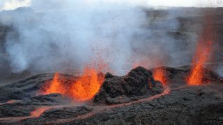 A picture taken on May 26, 2016 on the French island of La Reunion shows lava during the eruption of the Piton de la Fournaise volcano, in an unhabitated area.   The last Piton de la Fournaise's eruption occured on October 30, 2015.  / AFP PHOTO / RICHARD BOUHET