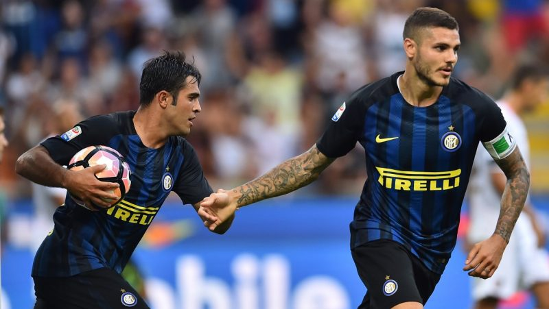"Inter Milan's forward from Argentina Mauro Icardi (R) celebrates after scoring a goal next to Inter Milan's midfielder from Argentina Ever Banega during the Italian Serie A football match Inter Milan vs Palermo at ""San Siro"" Stadium in Milan on August 28, 2016.  / AFP PHOTO / GIUSEPPE CACACE"