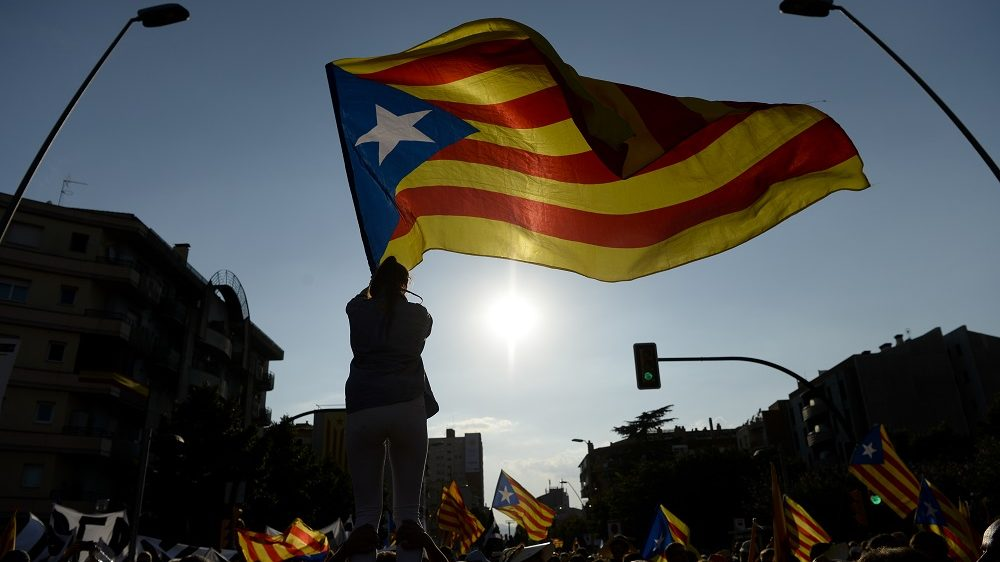 People wave 'Estaladas' (pro-independence Catalan flags) as they gather during a pro-independence demonstration, on September 11, 2016, in Barcelona during the National Day of Catalonia 'Diada'. The 'Diada' marks the date (September 11, 1714) when Barcelona fell to Spanish and French forces in the War of Succession, that redrew the map of Spain. Tens of thousands of Catalans gathered in Barcelona and four other cities today for mass rallies to demand their region break away from Spain, as pro-independence leaders try to iron out differences over a secession plan.   / AFP PHOTO / JOSEP LAGO