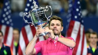 Stan Wawrinka of Switzerland poses with the championship trophy after defeating Novak Djokovic of Serbia in their 2016 US Open Men's Singles final match at the USTA Billie Jean King National Tennis Center in New York on September 11, 2016. Stan Wawrinka became the oldest US Open men's champion in 46 years when he defeated world number one Novak Djokovic to claim a third Grand Slam title on Sunday. / AFP PHOTO / Jewel SAMAD