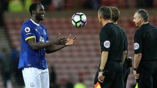 Everton's Belgian striker Romelu Lukaku (L) throws the ball in jst towards the officials following the English Premier League football match between Sunderland and Everton at the Stadium of Light in Sunderland, north-east England on September 12, 2016. Everton won the match 3-0. / AFP PHOTO / SCOTT HEPPELL / RESTRICTED TO EDITORIAL USE. No use with unauthorized audio, video, data, fixture lists, club/league logos or 'live' services. Online in-match use limited to 75 images, no video emulation. No use in betting, games or single club/league/player publications.  /