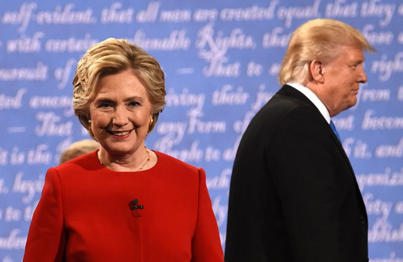 Democratic nominee Hillary Clinton (L) and Republican nominee Donald Trump leave the stage after the first presidential debate at Hofstra University in Hempstead, New York on September 26, 2016. / AFP PHOTO / Timothy A. CLARY