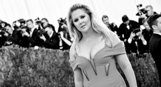 """NEW YORK, NY - MAY 02: (EDITORS NOTE: Image has been converted to black and white.) Amy Schumer attends the """"Manus x Machina: Fashion In An Age Of Technology"""" Costume Institute Gala at Metropolitan Museum of Art on May 2, 2016 in New York City.   Mike Coppola/Getty Images for People.com/AFP"""
