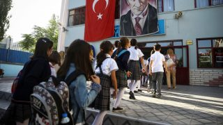 ANKARA, TURKEY - SEPTEMBER 19: Students enter their school building during the first day of the 2016-2017 school year in Ankara, Turkey on September 19, 2016.   Ercin Top / Anadolu Agency