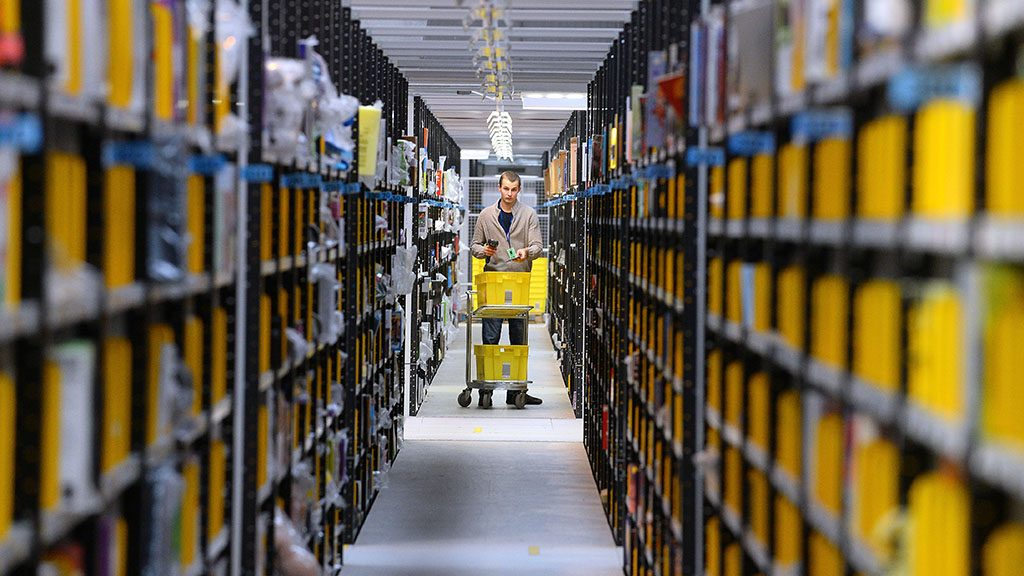 A 'picker' gathers items at Amazon's Fulfilment Centre in Peterborough, central England, on November 28, 2013. 'Cyber Monday' which falls this year on Monday December 2, 2013, is expected to be the busiest online shopping day in Britain. AFP PHOTO/ANDREW YATES / AFP PHOTO / ANDREW YATES