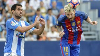 Barcelona's Argentinian forward Lionel Messi (R) heads the ball past Leganes' defender Pablo Insua during the Spanish league football match CD Leganes CF vs FC Barcelona at the Butarque municipal stadium in Leganes on September 17, 2016. / AFP PHOTO / PEDRO ARMESTRE