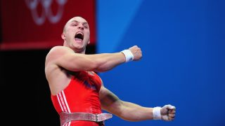 LONDON, ENGLAND - AUGUST 04: Anatoli Ciricu of Moldova celebrates during the Men's 94kg Weightlifting final on Day 8 of the London 2012 Olympic Games at ExCeL on August 4, 2012 in London, England.  (Photo by Mike Hewitt/Getty Images)