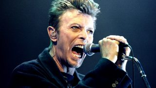 """David Bowie performs during a concert in Vienna, Austria in this February 4, 1996 file photo. David Bowie marked his 69th birthday on January 8, 2016 with the release of a new album, """"Blackstar"""", with critics giving the thumbs up to the latest work in a long and innovative career. REUTERS/Leonhard Foeger/Files"""