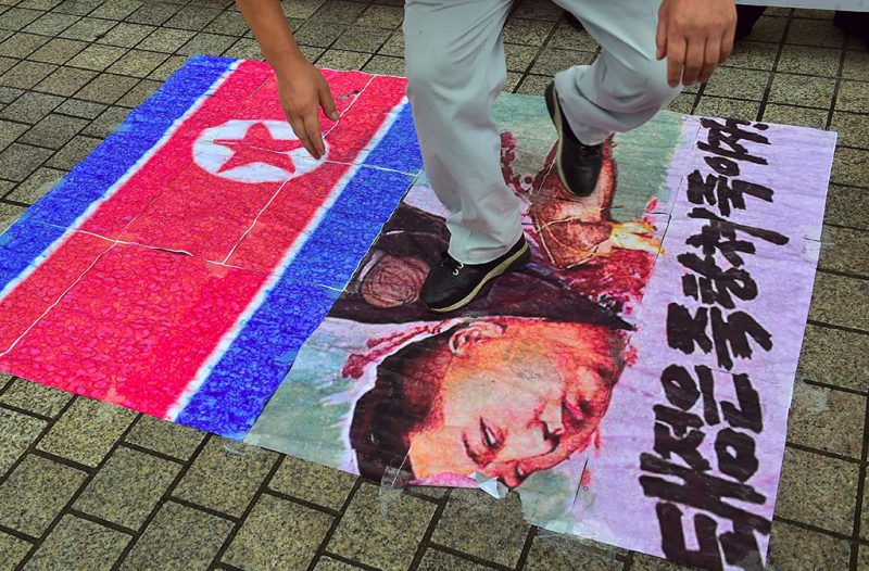 A South Korean activist tramples on an caricature picture of North Korean leader Kim Jong-Un during a protest denouncing North Korea's latest nuclear test in Seoul on September 12, 2016.North Korea is ready to conduct another nuclear test at any time, South Korea's defence ministry said on September 12, just days after Pyongyang sparked worldwide condemnation with its fifth and most powerful test. / AFP PHOTO / JUNG YEON-JE