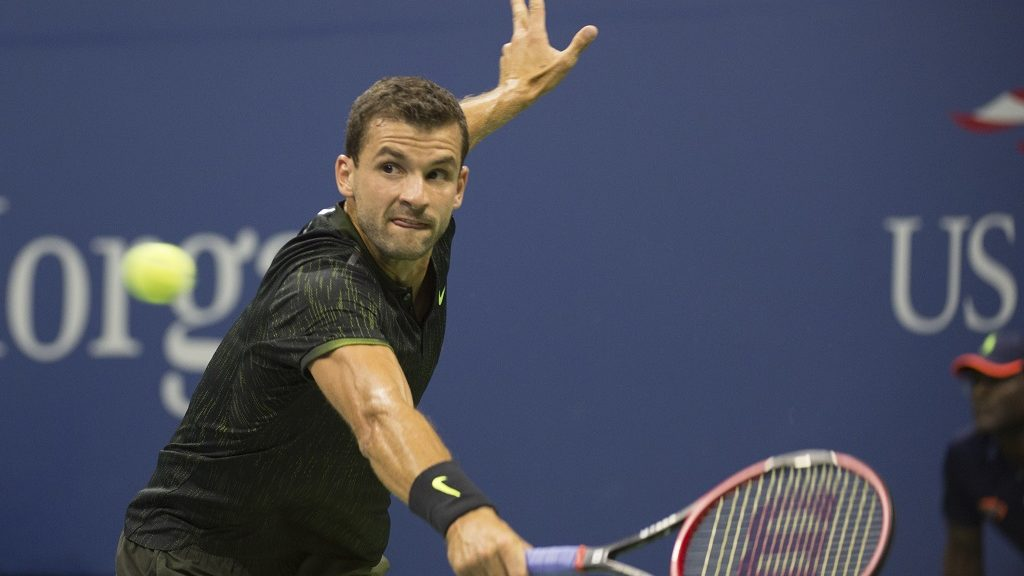 Grigor Dimitrov of Bulgaria hits a return to Andy Murray of Great Britain during their 2016 US Open men's singles match at the USTA Billie Jean King National Tennis Center on September 5, 2016 in New York. / AFP PHOTO / DON EMMERT