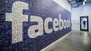 (FILES) This file photo taken on November 7, 2013 shows a logo created from pictures of Facebook users worldwide is pictured in the company's Data Center, its first outside the US in Lulea, in Swedish Lapland. / AFP PHOTO / JONATHAN NACKSTRAND