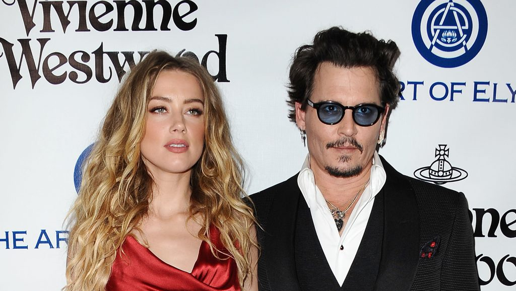 CULVER CITY, CA - JANUARY 09:  Actress Amber Heard and actor Johnny Depp attend Art of Elysium's 9th annual Heaven Gala at 3LABS on January 9, 2016 in Culver City, California.  (Photo by Jason LaVeris/FilmMagic)