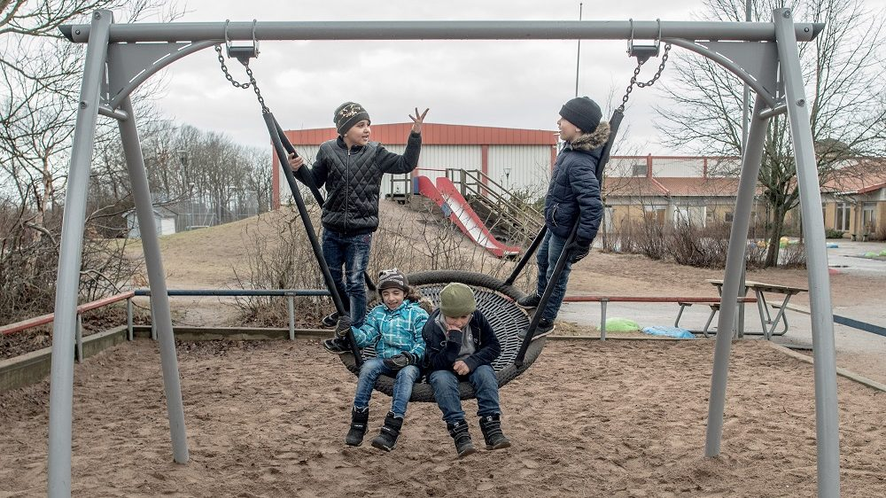 HALMSTAD, SWEDEN - FEBRUARY 08:  Refugee children have fun in the playground of a school on February 8, 2016 in Halmstad, Sweden. Last year Sweden received 162,877 asylum applications, more than any European country proportionate to its population. According to the Swedish Migration Agency, Sweden housed more than 180,000 people in 2015, more than double the total in 2014. The country is struggling to house refugees in proper conditions during the harsh winter; summer holiday resorts, old schools and private buildings are being turned into temporary shelters for asylum seekers as they wait for a decision on their asylum application. Sweden is facing new challenges on its migration policy after the massive arrival of refugees last year, forcing the country to drastically reduce the number of refugees passing through its borders. Stricter controls have had a significant effect on the number of arrivals, reducing weekly numbers from 10,000 to 800. The Swedish migration minister announced in January that the government will reject up to 80,000 refugees who applied for asylum last year, proposing strict new residency rules.  (Photo by David Ramos/Getty Images)