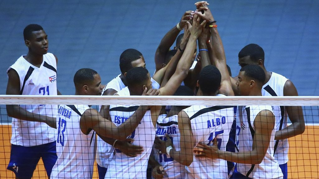 MEXICO CITY, MEXICO - MAY 23: Players of Cuba celebrate during a match between Canada and Cuba as part of Men's Panamerican Volleyball Cup at Gimnasio Ol'mpico Juan de la Barrera on May 23, 2016 in Mexico City, Mexico. (Photo by Hector Vivas/LatinContent/Getty Images)