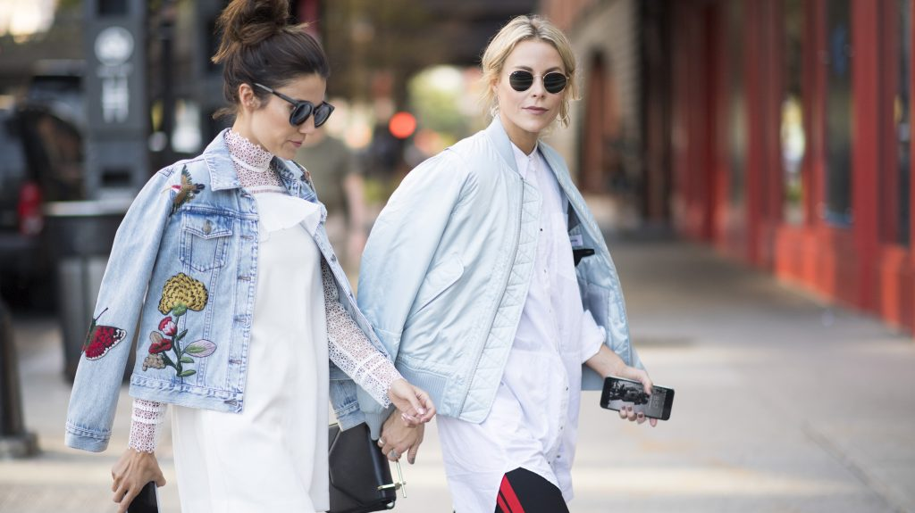NEW YORK, NY - SEPTEMBER 08:  Christine Andrew and Mary Seng is wearing a Tom coopens bomber, Alexander wang button up, Zara pant, m2malleteir bag, Phillip lim boots seen in the streets of Manhattan on September 8, 2016 in New York City.  (Photo by Timur Emek/Getty Images)