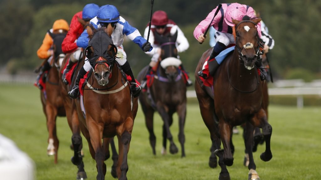 ESHER, ENGLAND - SEPTEMBER 09: Kieren Fox riding First Experience (L) win The Kingsway Claims Fillies' Handicap Stakes at Sandown Park on September 9, 2016 in Esher, England. (Photo by Alan Crowhurst/Getty Images)
