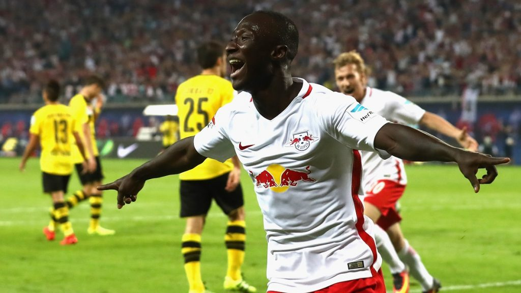 LEIPZIG, GERMANY - SEPTEMBER 10:  Naby Deco Keita of Leipzig celebrates scoring the first goal during the Bundesliga match between RB Leipzig and Borussia Dortmund at Red Bull Arena on September 10, 2016 in Leipzig, Germany.  (Photo by Alexander Hassenstein/Bongarts/Getty Images)