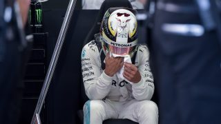Mercedes AMG Petronas F1 Team's British driver Lewis Hamilton sits during a practice session ahead of the Singapore Grand Prix night race in Singapore on September 16, 2016. / AFP PHOTO / Anthony WALLACE