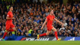 Liverpool's English midfielder Jordan Henderson (R) celebrates scoring his team's second goal during the English Premier League football match between Chelsea and Liverpool at Stamford Bridge in London on September 16, 2016. / AFP PHOTO / GLYN KIRK / RESTRICTED TO EDITORIAL USE. No use with unauthorized audio, video, data, fixture lists, club/league logos or 'live' services. Online in-match use limited to 75 images, no video emulation. No use in betting, games or single club/league/player publications.  /
