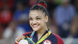 Silver medallist US gymnast Lauren Hernandez celebrates on the podium of the women's balance beam event final of the Artistic Gymnastics at the Olympic Arena during the Rio 2016 Olympic Games in Rio de Janeiro on August 15, 2016. / AFP PHOTO / Thomas COEX