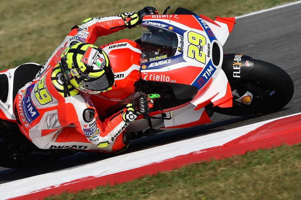 "Ducati Team's Italian rider Andrea Iannone rides his bike during the first practice session at ""Marco Simoncelli Circuit"" ahead of San Marino MotoGP Grand Prix race in Misano on September 9, 2016.  / AFP PHOTO / GIUSEPPE CACACE"