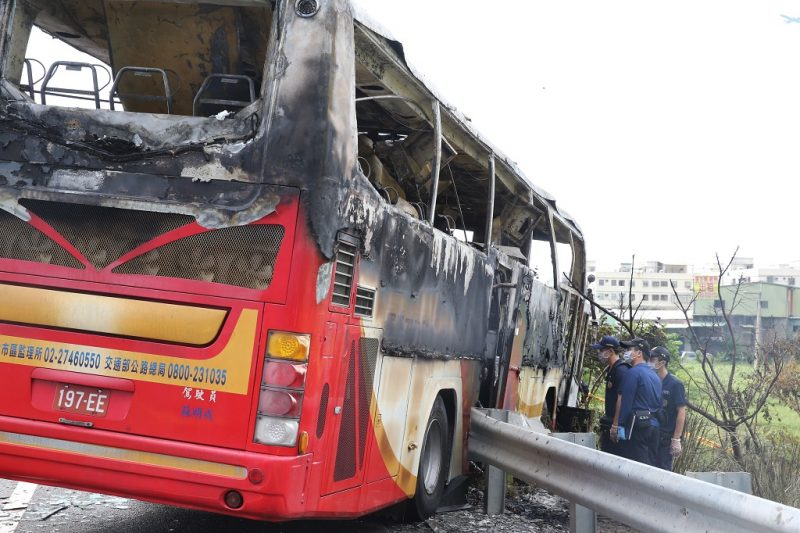 TAOYUAN, TAIWAN - JULY 19:  Investigators work around the wreckage of a damaged bus as the bus carrying tourists from mainland China crashed and caught fire along an expressway on its way to the airport on July 19, 2016 in Taoyuan, Taiwan of China. A Taiwan tour bus carrying visitors from mainland China crashed en route to Taoyuan airport, just south of the capital Taipei on Saturday afternoon, killing all 26 on board, including 24 tourists, one driver and one tour guide.  (Photo by VCG/VCG via Getty Images)
