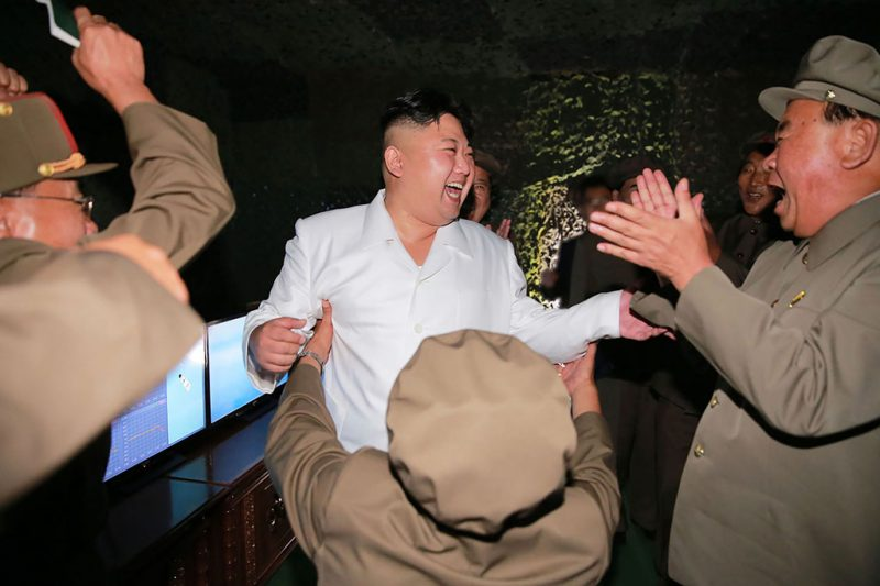 """This undated picture released from North Korea's official Korean Central News Agency (KCNA) on August 25, 2016 shows North Korean leader Kim Jong-Un (C) laughing as he inspects a test-fire of strategic submarine-launched ballistic missile at an undisclosed location. / AFP PHOTO / KCNA / KNS / South Korea OUT / REPUBLIC OF KOREA OUT  / SOUTH KOREA OUT ---EDITORS NOTE--- RESTRICTED TO EDITORIAL USE - MANDATORY CREDIT """"AFP PHOTO/KCNA VIA KNS"""" - NO MARKETING NO ADVERTISING CAMPAIGNS - DISTRIBUTED AS A SERVICE TO CLIENTSTHIS PICTURE WAS MADE AVAILABLE BY A THIRD PARTY. AFP CAN NOT INDEPENDENTLY VERIFY THE AUTHENTICITY, LOCATION, DATE AND CONTENT OF THIS IMAGE. THIS PHOTO IS DISTRIBUTED EXACTLY AS RECEIVED BY AFP.  /"""