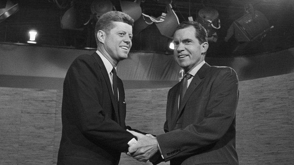 Presidential candidates John F. Kennedy and Richard Nixon shake hands after their televised debate of October 7, 1960. The two opponents continued their debate after the cameras had stopped.