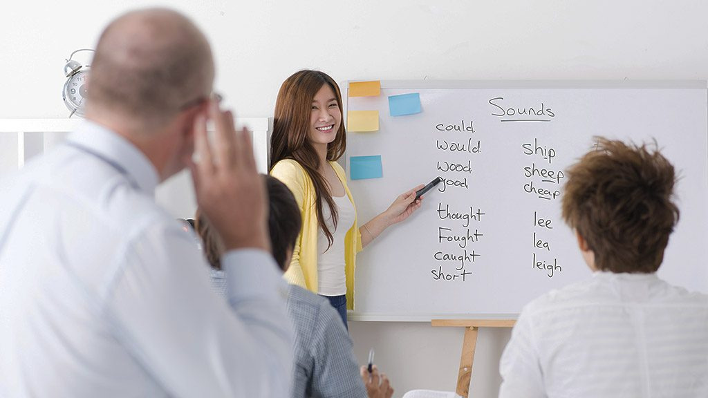 Asian students learning the English language at class