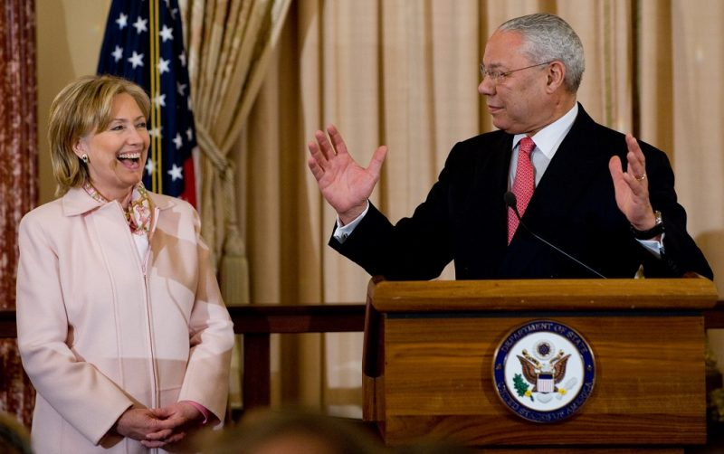 Former US Secretary of State Colin Powell speaks alongside US Secretary of State Hillary Clinton during the unveiling of Powell's official State Department portrait in the Benjamin Franklin Room at the State Department in Washington, DC, on December 7, 2009. Powell served as Secretary of State from 2001-2005 under former US President George W. Bush. AFP PHOTO / Saul LOEB / AFP PHOTO / SAUL LOEB