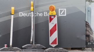 Posts outside a construction site fence near the Deutsche Bank headquarters in Frankfurt am Main, Germany, 28 September 2016. The bank has denied a report that says the German government and financial regulator are working on a rescue plan in case of financial troubles at the bank.  PHOTO: BORIS ROESSLER/DPA