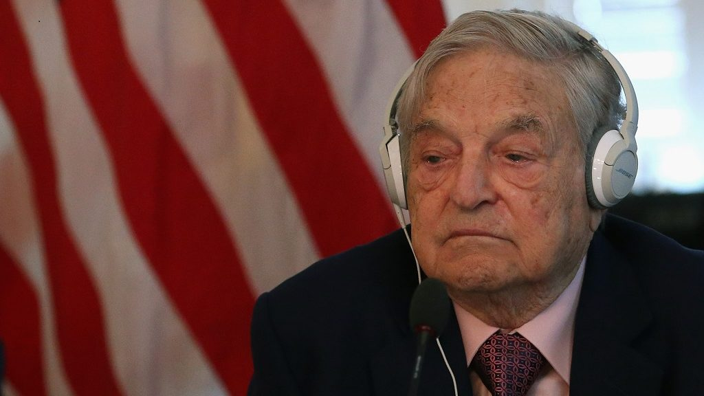 """WASHINGTON, DC - MAY 20: Billionaire George Soros litens to remarks by Commerce Secretary Penny Pritzker and Tunisian President Beji Caid Essebsi during a roundtable discussion with a group of American business leaders, at the Blair House May 20, 2015 in Washington, DC. The US Commerce Department hosted the discussion titles as the status of reforms that are critical to increasing commercial opportunities in Tunisia and improving the country's investment climate.""""   Mark Wilson/Getty Images/AFP / AFP PHOTO / GETTY IMAGES NORTH AMERICA / MARK WILSON"""