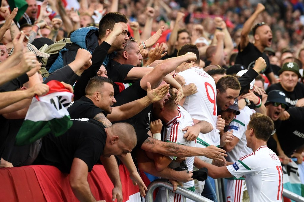 Hungary's forward Adam Szalai (C) celebrates with fans after scoring his team's first goal during the Euro 2016 group F football match between Hungary and Austria at the Matmut Atlantique stadium in Bordeaux on June 14, 2016. / AFP PHOTO / Mehdi FEDOUACH