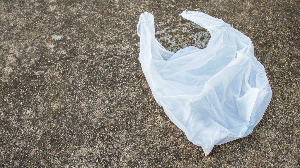 White plastic bags lay on the concrete floor