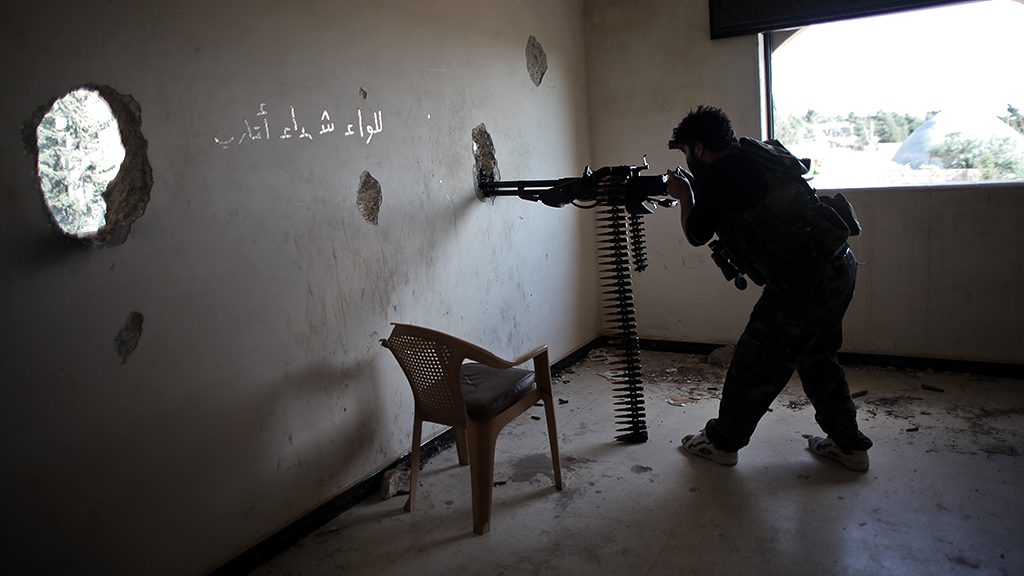 A Free Syrian Army fighter fires his heavy weapon during clashes with forces loyal to Syria's President Bashar al-Assad in the Khan al-Assal town for the control of the town near Aleppo on May 30, 2013. Regime and opposition forces are fighting for the control of the Khan Al-Assal area as it is the main gateway to Aleppo, which lies 12km (7 miles) west of the city, as well as for its large inventory of fuel and oil. (Photo by Ahmed Deeb/NurPhoto) (Photo by NurPhoto/Corbis via Getty Images)