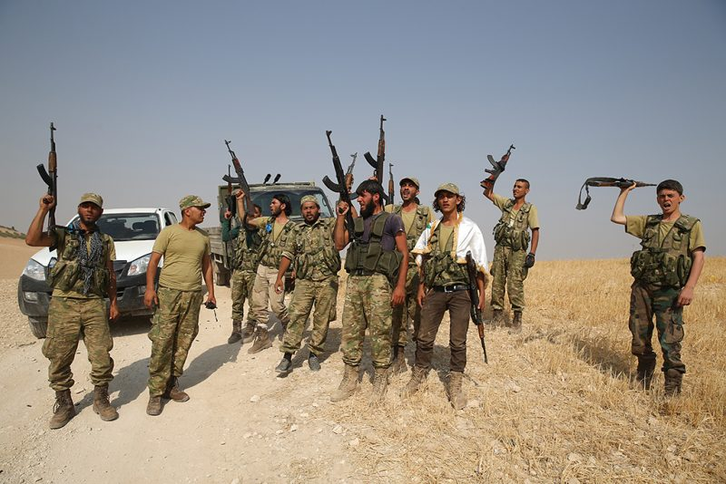 """ALEPPO, SYRIA - AUGUST 31: Free Syrian Army (FSA) members are seen at the area where Sacur Brook located after taking control of the area from Daesh terrorists during the """"Operation Euphrates Shield"""" led by Turkish Army and backed by Syrian National Coalition forces including Free Syrian Army (FSA) on August 31, 2016. The anti-Daesh operation, called Euphrates Shield, is aimed at clearing terrorist groups from the Turkish border region, tightening border security, and supporting Syrias territorial integrity. (Photo by Cem Ozdel/Anadolu Agency/Getty Images)"""