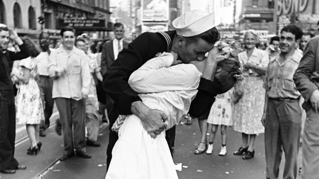 """Subject: Contact print of negative strip showing Times Square celebration of  VJ-Day & the end of WWII, including the famous """"sailor kissing the nurse"""" image. New York, New York August 14, 1945 Photographer- Alfred Eisenstaedt Time Inc owned Merlin- 1200624"""