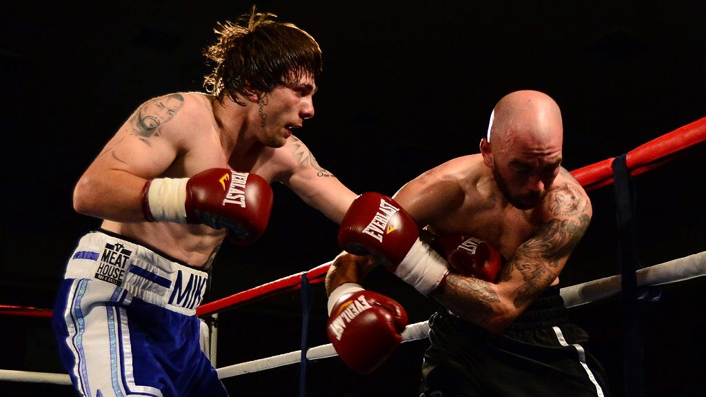 GLASGOW, SCOTLAND MAY 23 : Mike Towell  (blue short), of Dundee takes on Danny Little of Driffield during a Welterweight match up at Glasgow's Bellahouston Leisure Centre on May 23, 2015 in Glasgow, Scotland. (Photo by Mark Runnacles/Getty Images)