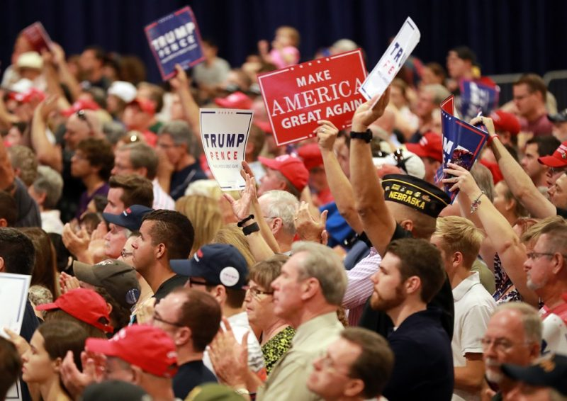 Supporters cheer as Republican presidential nominee Donald Trump unveils his 10-point plan to crack down on illegal immigration during a campaigm event inside the Phoenix Convention Center on August 31, 2016 in Phoenix, Arizona.  Trump issued a stern warning to people intent on sneaking into the United States, saying those who enter illegally would never obtain legal status.  / AFP PHOTO / Digital / DAVID CRUZ