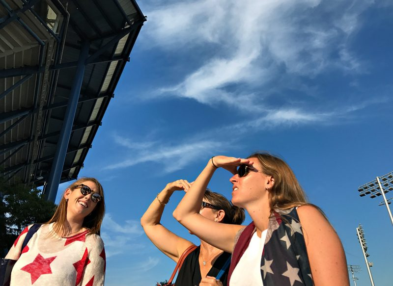 NEW YORK, NY - SEPTEMBER 08:  Spectators wearing stars and stripes watch action on the big screen in front of Arthur Ashe Stadium on Day Eleven of the 2016 US Open at the USTA Billie Jean King National Tennis Center on September 8, 2016 in Queens.  (Landon Nordeman for ESPN)
