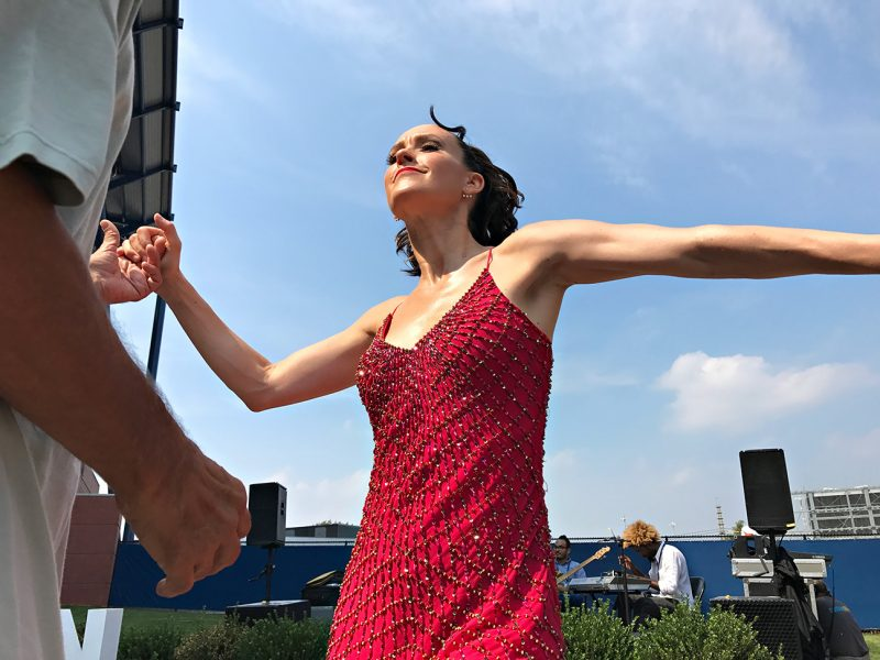 NEW YORK, NY - SEPTEMBER 10:  Professional salsa dancer Kirsten O'Brien Cha Chas with spectator Damian Mojica from Brooklyn during Day Thirteen of the 2016 US Open at the USTA Billie Jean King National Tennis Center on September 10, 2016 in Queens.  (Landon Nordeman for ESPN)